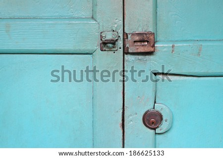 Aged steel cupboard safety padlock door latch - stock photo