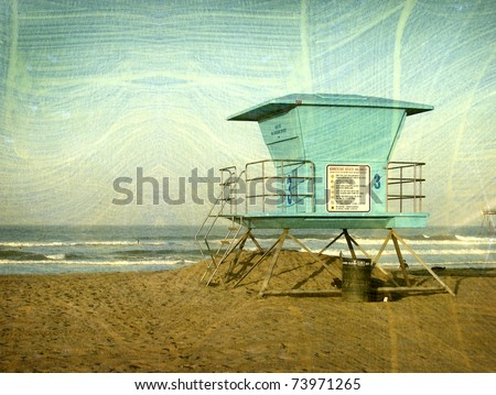 aged vintage photo of lifeguard tower on beach with surfers in background - stock photo