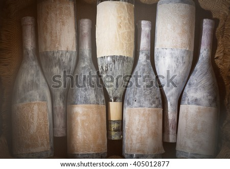 Aged wine bottles in a wine cellar - stock photo