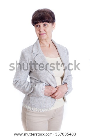 Aged woman posing like an office worker, administrator, secretary. Portrait against of white background - stock photo