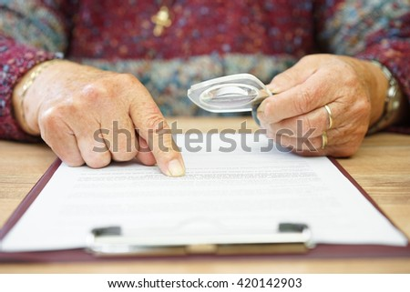 aged woman reading document - stock photo