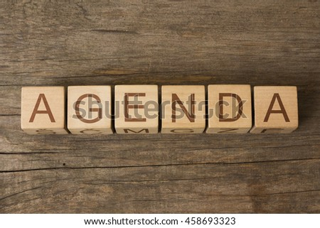 agenda text on wooden cubes - stock photo