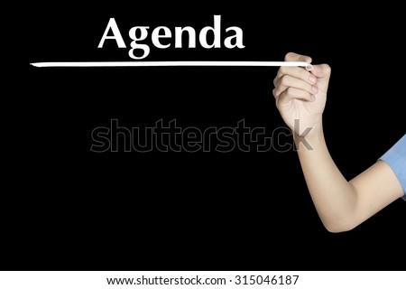 Agenda Woman writing word with black screen - stock photo