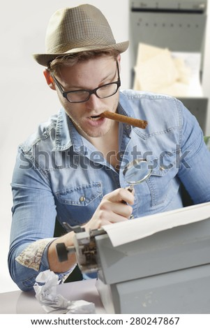 Agent with an old type writer and cigar - stock photo