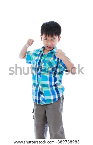 Aggressive asian child. Boy looking furious. Isolated on white background. Negative human face expressions, emotions, reaction, conflict, confrontation. Concept about aggressive behavior in childhood. - stock photo