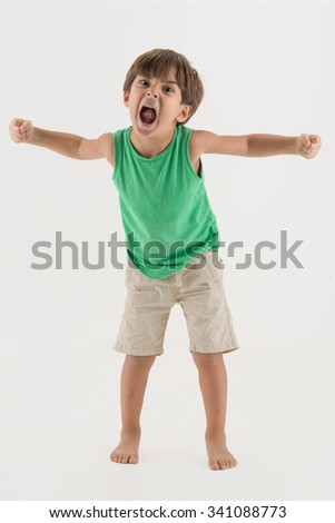 Aggressive child showing his fist and ready to fight hign tension - stock photo