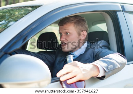 Aggressive drunk driver behind the wheel of of the car - stock photo