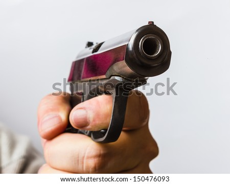 Aggressive man with a black gun in his hand - stock photo