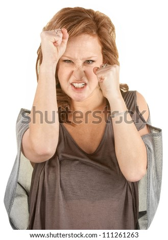 Aggressive woman with fists up on isolated background - stock photo