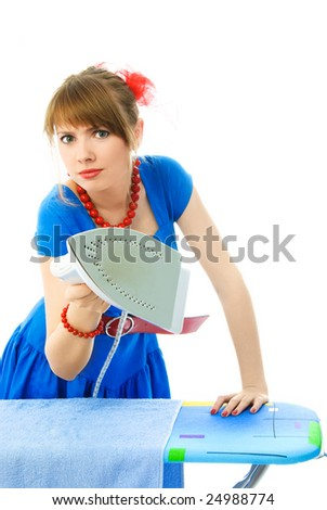 aggressive young housewife ironing the towel against white background - stock photo