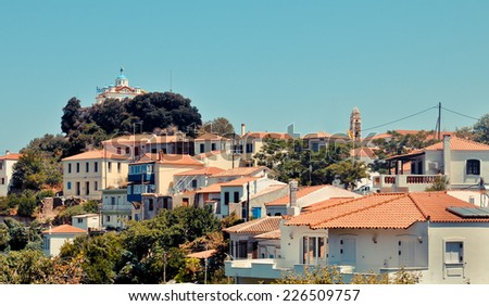 Agia Triada church over Paleo Karlovasi roofs, Samos, Greece - stock photo