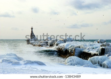 Aging pier in ice. The Sea pier cover ice. The Winter evening seaborne. The Frost and wind. - stock photo