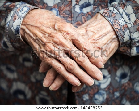 Aging process - very old senior woman hands wrinkled skin - stock photo