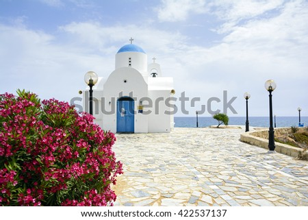 Agios Nikolaos in Protaras, Cyprus - small, beautiful greek-style church near the sea during sunny day - stock photo