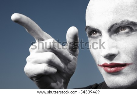 Agnry clown outdoors pointing finger. Horizontal photo - stock photo