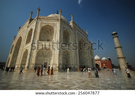 AGRA, INDIA - APRIL 17 : Unidentified tourists visit India's most famous icon, the Taj Mahal on April 17,2011 in Agra, India. The Taj Mahal designated a UNESCO World Heritage Site in 1983. - stock photo
