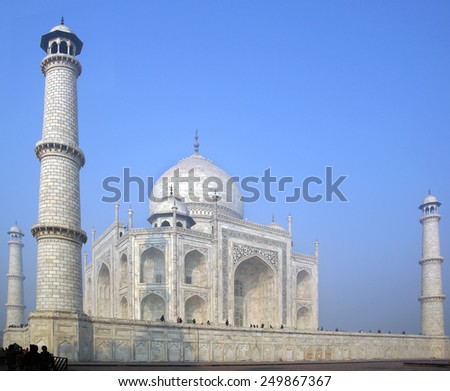 AGRA, INDIA - DECEMBER 29, 2011: Taj Mahal is a white marble mausoleum. Construction began 1632 and was completed 1653, employing thousands of artisans and craftsmen.  - stock photo