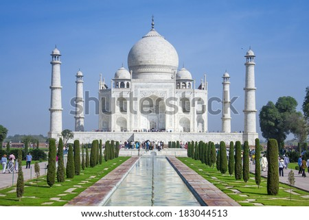 AGRA, INDIA - FEB 23: The people visit Taj Mahal, Agra, India on February 23, 2009. The Taj Mahal is a mausoleum located in Agra, India and is one of the most  recognizable structures in the world  - stock photo