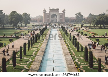AGRA, INDIA - 28 FEBRUARY 2015: View of North side of Great Gate from Taj Mahal with visitors. Post-processed with grain, texture and colour effect. - stock photo