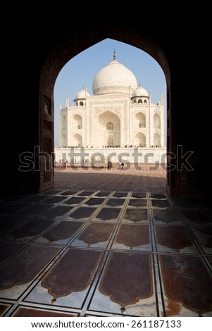 Agra, India - January 10, 2015 : The side of the Taj Mahal at sunset seen from the mosque at the western side - stock photo