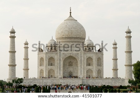 AGRA, INDIA - JUNE 17: People visiting the most known religious site in India - the Taj Mahal mosque in Agra on June 17, 2007 in Agra, India. It's one of The Seven Wonders of the World - stock photo