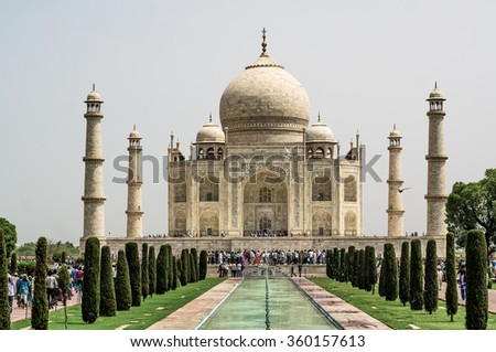Agra, India, - June 08, 2013:Tourists visit Taj Mahal, Agra, India The Taj Mahal is a white marble mausoleum located on the southern bank of the Yamuna River in the Indian city of Agra.  - stock photo