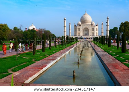 Agra, Uttar Pradesh, India - March 19, 2011: Visitors at the Taj Mahal complex on March 19, 2011, in Agra, Uttar Pradesh, India. - stock photo