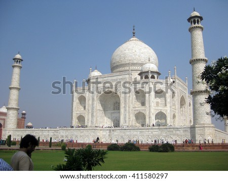 Agra, Uttar Pradesh, India - October 2011: Garden view of the Taj Mahal, one of the New Seven Wonders of the World.  - stock photo
