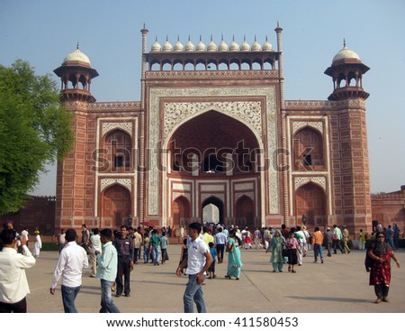 Agra, Uttar Pradesh, India - October 2011: Tourists at the entrance of the Taj Mahal. - stock photo