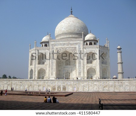 Agra, Uttar Pradesh, India - October 2011: View of the Taj Mahal, one of the New Seven Wonders of the World and visitors. - stock photo