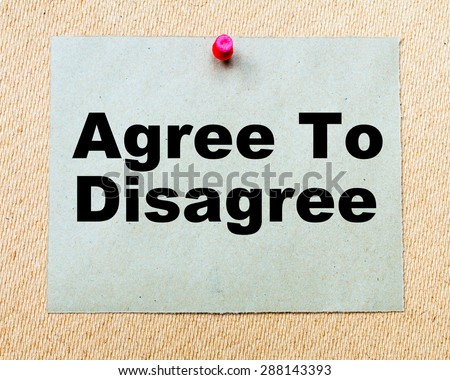 Agree To Disagree written on paper note pinned with red thumbtack on wooden board. Business conceptual Image - stock photo