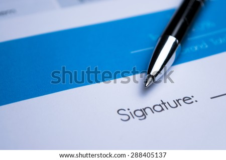 Agreement - signing a contract - stock photo