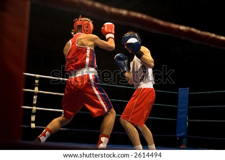 Agressive boxing fight, two boxers fighting on the ring - stock photo
