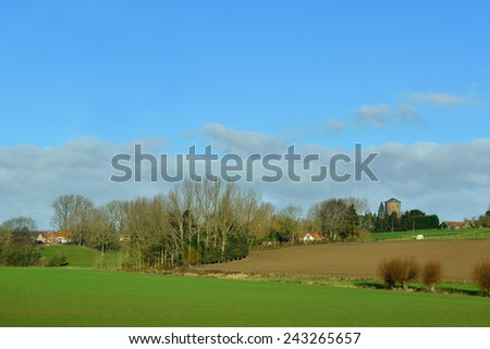 Agricultural landscape of Flemish Ardennes in warm winter day - stock photo