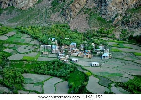Agricultural landscape with blue river, Northern India - stock photo