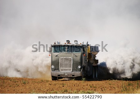 Agricultural lime being spread on a newly created field in the Garden Valley area of Roseburg Oregon.  This operation caused a smoke scare fire response by local fire departments. - stock photo
