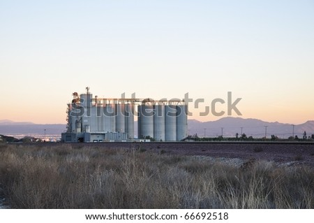 Agricultural mill evening sky - stock photo