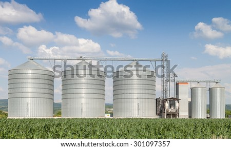 Agricultural Silo - Building Exterior, Storage and drying of grains, wheat, corn, soy, sunflower - stock photo