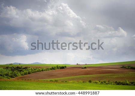 Agricultural Village Green Vitality Field In Springtime - stock photo