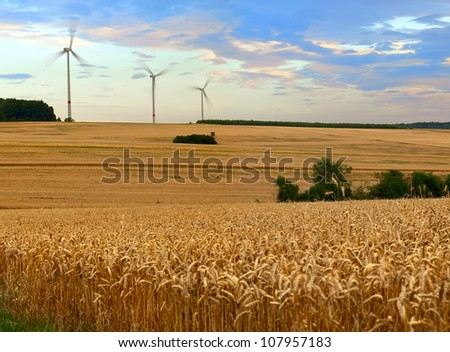 Agriculture landscape with wind turbines, by Beckingen, Saarland - Germany, warm evening sun, stitched - original size - stock photo
