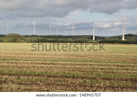 Agriculture landscape with wind turbines in Germany - stock photo