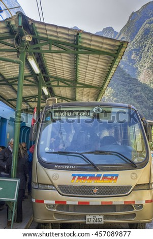 AGUA CALIENTES,PERU-July 24,2014: One of the many busses that bring tourists from Agua Calientes to Machu Picchu in Peru - stock photo