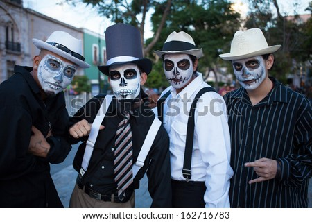 AGUASCALIENTES, MEXICO, NOV 02: Unknown men on a carnival of the Day of the Dead, Aguacalientes, Mexico, 02 November 2013. The Day of the Dead is one of the most popular holidays in Mexico - stock photo