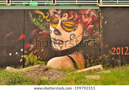 "AGUASCALIENTES, MEXICO - OCTOBER 19, 2013:  Graffiti of ""La Calavera Catrina"", the work of cartoon illustrator Jose Guadalupe Posada. Catrina is icon of Mexican Day of the Dead (Dia de muertos)  - stock photo"