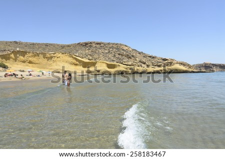 Aguilas, Spain - July 16 People enjoying on the beautiful cove of La Carolina in summer. Aguilas, Murcia July 16, 2013 - stock photo