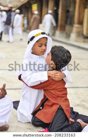 AHMEDABAD, GUJARAT/INDIA - 29TH AUGUST 2014 : Unidentified  Muslim  boys celebrating Eid al-Fitr which marks the end of the month of Ramadan,  in Jama Masjid,Ahmedabad, India.   - stock photo
