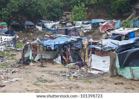 AHMEDABAD, INDIA - SEPTEMBER 7: Poor slum at September 7, 2011 in Ahmedabad, India. About 40 % of Ahmedabad inhabitants live in slums. - stock photo