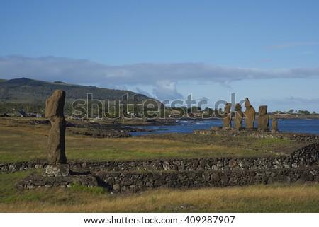 Ahu Tahai. Ancient Moai statues on the coast of Rapa Nui (Easter Island) - stock photo