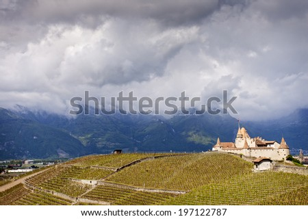 Aigle Castle on a cloudy day in spring - stock photo