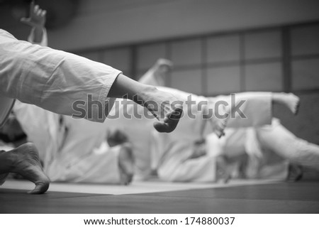 Aikido balance exercise - legs in the air - stock photo